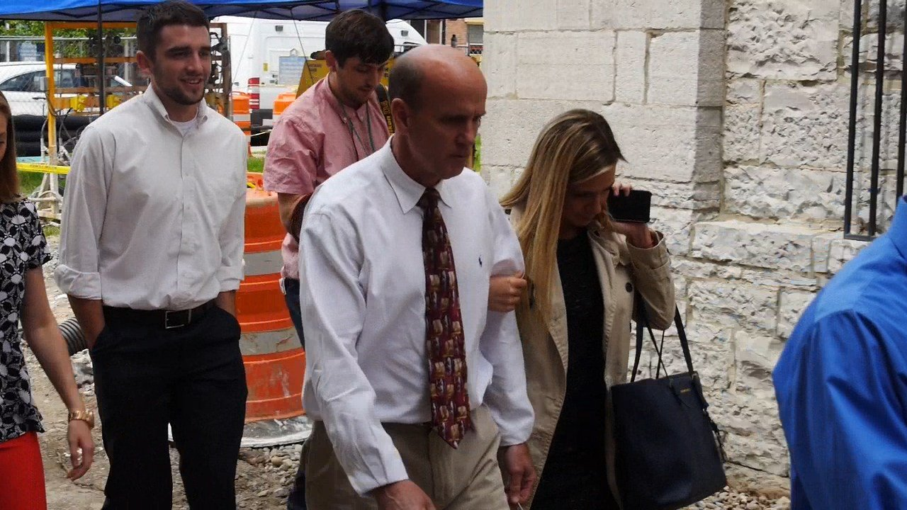 Cal Harris leaves Schoharie Courthouse with family members