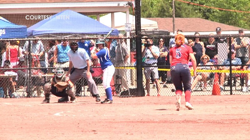 Paige Rauch delivers a pitch during the Patriots first game of the day