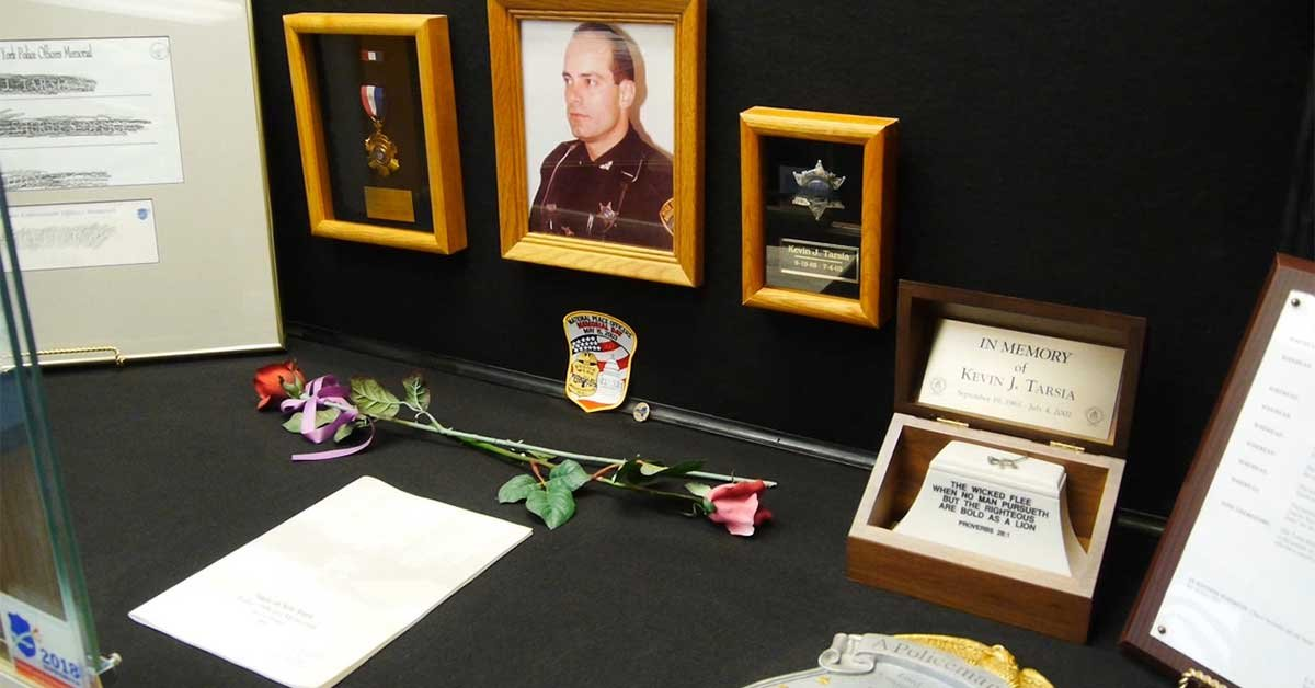 The life of Deputy Kevin Tarsia displayed at a new mobile police memorial on March 7, 2018.