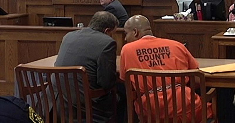 Aaron Powell confers with his lawyer during his 2014 murder trial.